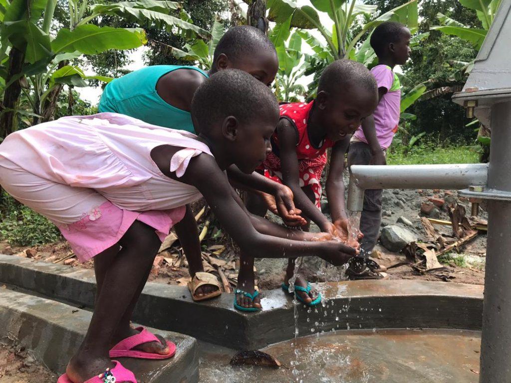 Children enjoying clean water